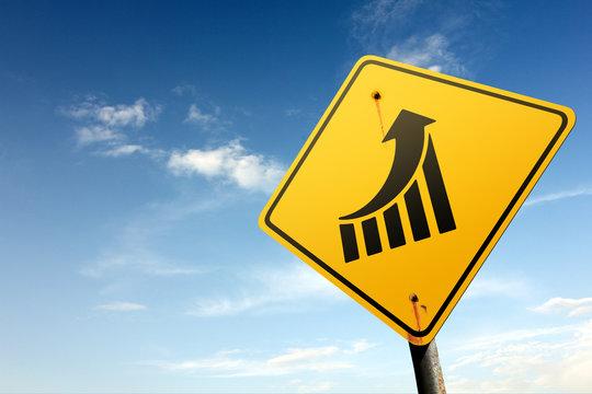 Increase earnings zone ahead. Yellow traffic sign.