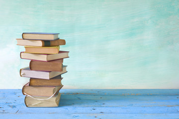 stack of books, grungy background,free copy space