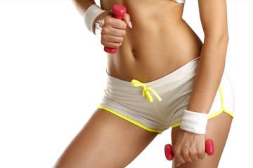 Closeup of a girl exercising with dumbbells