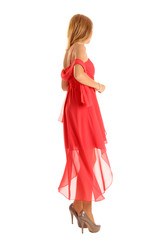 Tanzende Frau in rotem Ballkeid
