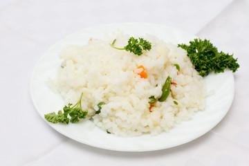 Plate full of rice on white
