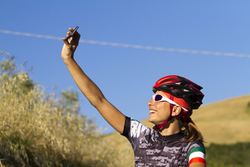 young girl cyclist you take a selfie with your smartphone