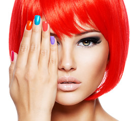 Close-up face of a beautiful  girl with bright multicolor nails.