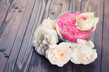 Sea salt in bowl with roses