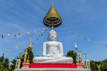 big white buddha  statue sitting  in thai  temple