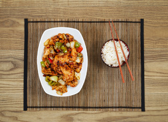 Spicy Chinese Chicken Dish with Bowl of Rice