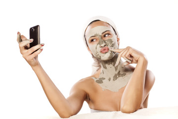 young girl make selfie with a mask on her face