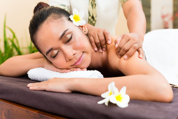 Indonesian Asian woman in wellness massage