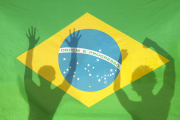 Brazilians Celebrating Shadows on Brazil Flag