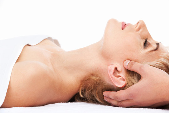 aged lady lying on massage bed.