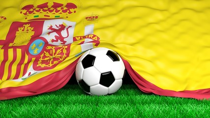 Soccer ball with Spanish flag on football field closeup