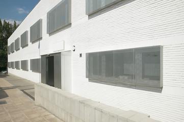 White building facade with metallic windows