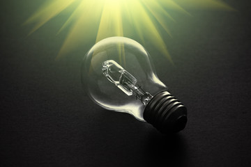 Halogen light bulb on dark background