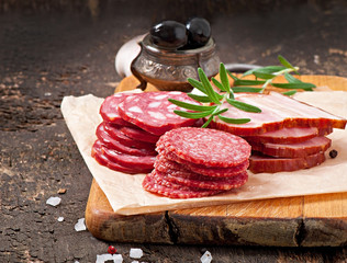 Assorted deli meats, rosemary and pepper