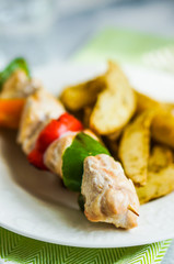 Chicken kebabs with baked potatoes