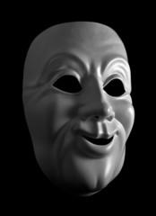 White mask against a dark background.
