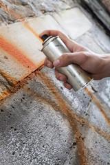 Painting graffiti on the wall