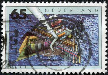 stamp printed in Netherlands shows ship and crane in sea port