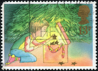 Stamp showing Child Decorating the Christmas Tree