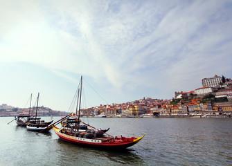 Douro riverside and boats with wine barrels, Porto, Portugal