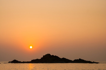 Rocky island silhouette and sunset in india
