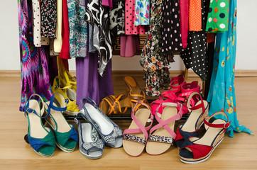 Closeup on summer sandals in a wardrobe. Tidy dressing closet.