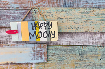 Happy or Moody sign board on wooden vintage background