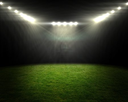Football pitch under bright spotlights