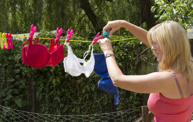 Woman hanging her bras on the washing line