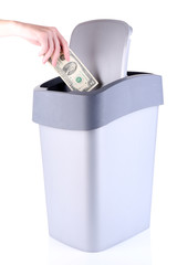 Throwing away your money, isolated on white
