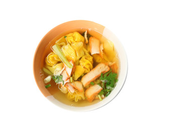 Wonton noodles soup in bowl of isolated.