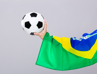 Man arm hold soccer ball