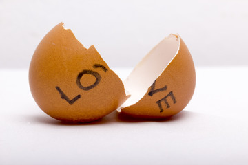 """LOVE"" written at broken eggs"