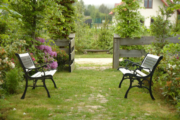 Two benches in garden