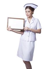 Young woman asian nurse Showing signboard