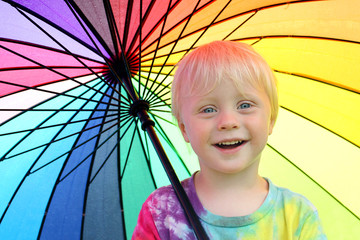 Cute Little Child Under Rainbow Colored Umbrella