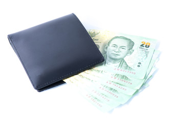 Money in leather wallet. Isolated on a white background.