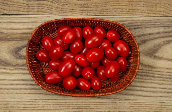 Basket of fresh Grape Tomatoes on Age Wood