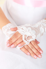 Wedding gloves on hands of bride, close-up