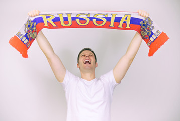 Man supports Russian team with Russian scarf.