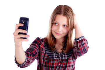 Happy teen girl make pictures of herself