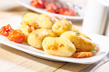 Roasted potatoes with carrot and tomatoes