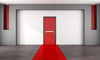 Empty room with red closed door