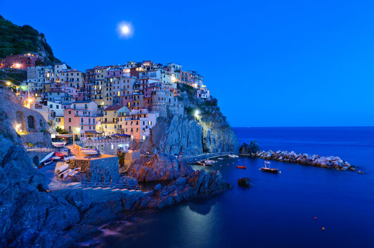 Village of Manarola at dusk in Cinqueterre, Italy