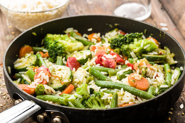 vegetable pan with fresh ingredients and rice