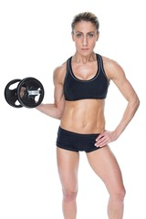 Female bodybuilder holding large black dumbbell with arm up look