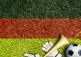 Aufkleber - German, the flag on the texture of the grass