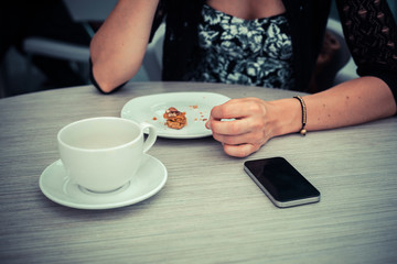 Woman having coffee waiting for phone call