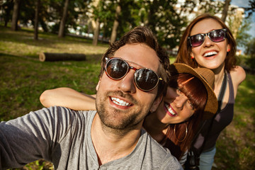 Three Young People Taking Selfie