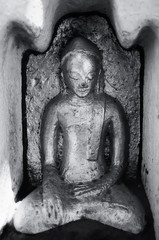 Black and white Sculpture of Buddha in Buddhist temple